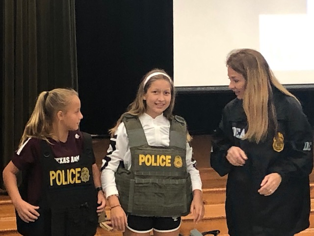 Students dressed up as officers
